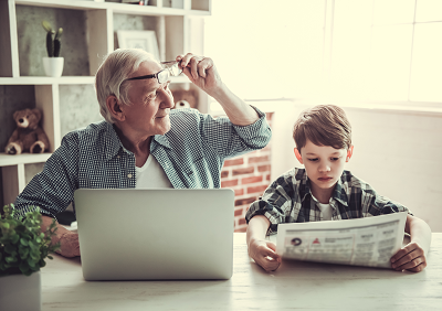 Grandfather and grandson reading
