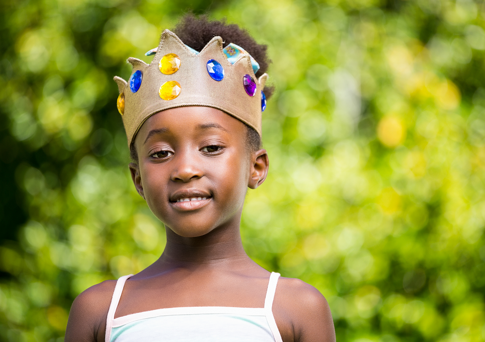 Girl wearing crown outside