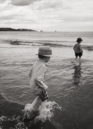 Boys playing in the sea