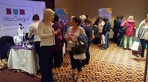 Exhibitors chatting at ERIC conference