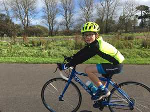 Boy taking part in charity bike ride