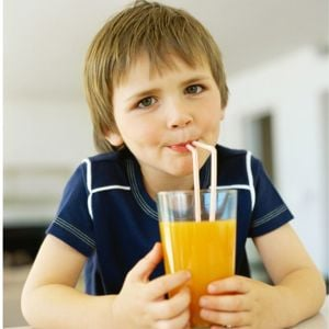 Boy drinking through a straw