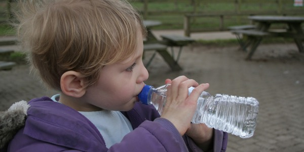 Child with bottle of water