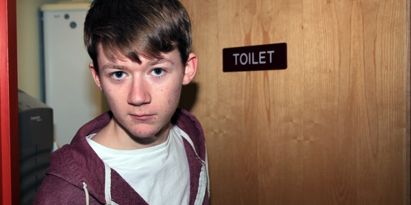 Boy by toilet