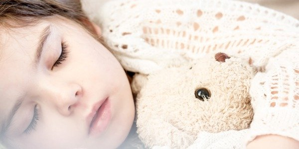 Sleeping girl with teddy