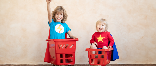Two children in shopping trolleys
