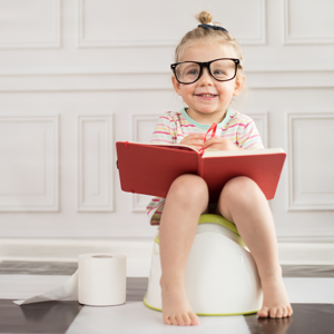 Girl on potty with glasses