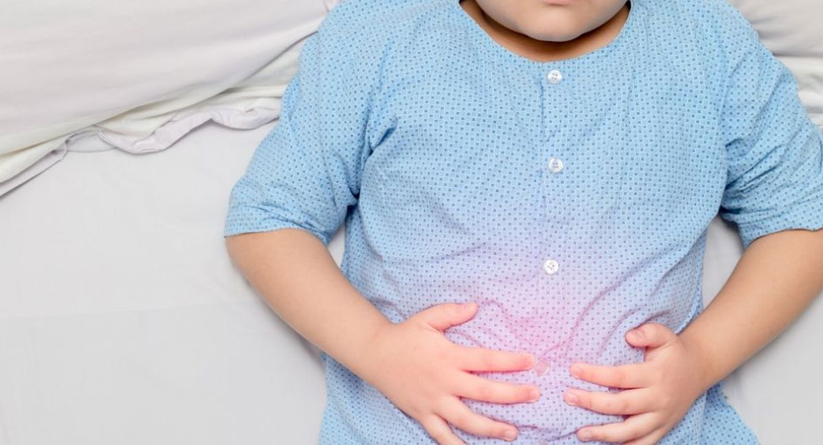 Child clutching stomach in pain