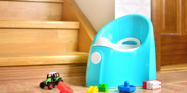 A blue potty and toys