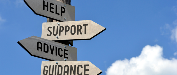 Sign pointing to help, support, advice and guidance